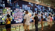"""The College Football Hall of Fame's """"Why We Love Football"""" features a 52-foot long multitouch interactive wall filled with customized RFID-driven content"""