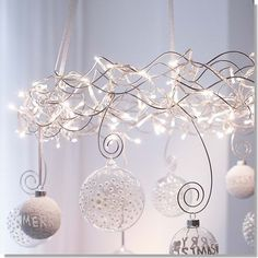 Love this floating lighted wire wreath with hanging balls.  I have several beautiful glass balls that are too large for my tree.  Now I know what to do with them!