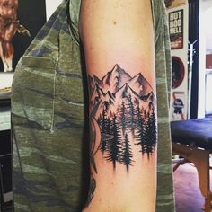 mountain tattoos...love the placement & the art
