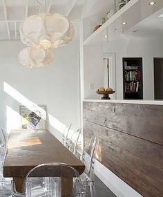 ghost chairs/chunky salvaged wood table/white laminate and rustic wood mixed cabinetry