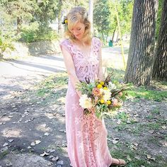Blush dress with wild flower bouquet wedding at Camp Wandawega by Heart of Harlow
