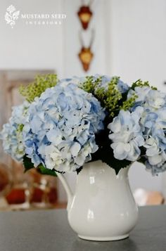 Blue hydrangeas in a white pitcher. - I have pitcher already.  Can also bring the wine decanters use as vases