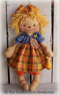 The Craftaholic Creations. Love the colors of her hair and clothes...so cute.