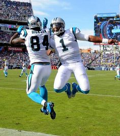 Carolina Panthers tight end Ed Dickson, left, and quarterback Cam Newton, right, celebrate their touchdown pass and reception vs theTennessee Titans during second quarter action at Nissan Stadium in Nashville, TN. on Sunday, November 15, 2015. The Panthers defeated the Titans 27-10.