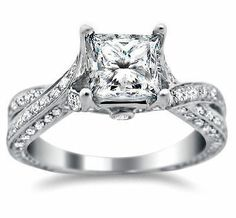 HERE IS THE WEBSITE : http://www.frontjewelers.net/engagement/engagement-rings/with-accents/round-diamond-criss-cross-engagement-ring-setting-14-k-white-gold.html#980=172 princess cut twist solitaire.
