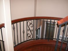 Now what about those stairs?  Wrought iron and cherry banister