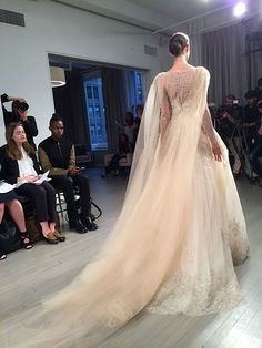 This flowy tulle cape from @m_lhuillier is perfection | Brides.com