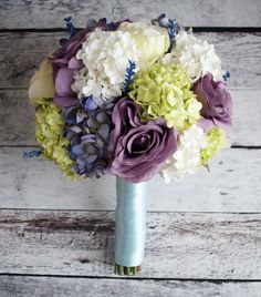 A bright and fun garden wedding bouquet with ivory, green and lavender hydrangeas, green and purple hydrangeas, and a little something blue for the handle.  Happy wedding, Kana!  By Kate Said Yes, www.katesaidyes.etsy.com