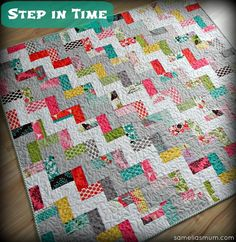 "Step in Time Quilt Tutorial 48 x 54"", 2 charm packs plus 1.25 yds. Of 2 solids, white and ash Kona solids here plus coordinated binding. Cut charm sq in 1/2, sew print to solid 2.5"" strip, place squares in alternating directions, 2 print/white then 2 print, ash alternating to form a stair step pattern. Would make great toddler quilt."