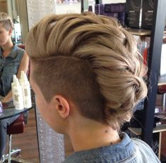 Shaved sided loosely braided Mohawk