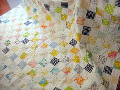 This quilt is made almost entirely from vintage fabric and reclaimed bed linens with the exception of the white (Kona Cotton) and the black and white gingham (Robert Kaufman). The quilting is done a quarter of an inch on. Gingham Quilt, Postage Stamp Quilt, Kona Cotton, Quilt Stitching, Linen Bedding, Linens, Nursery, Quilts, Blanket