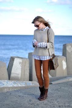 Plaid, oversized boyfriend sweater, skinny jeans, boots, satchel handbag.