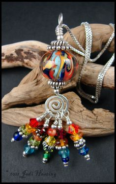 Rainbow pendant - Lampwork Glass and Sterling Silver. not so keen on the focal bead but am loving the drops