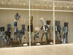 This window display shows great usage of functional props, such as mannequins, and decorative props. This display also shows good usage of fixtures. Denim Window Display, Window Display Retail, Window Display Design, Window Displays, Store Mannequins, Mannequin For Sale, Best Windows, White Backdrop, Retail Design