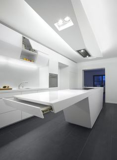 Futuristic hi-tech luxury white kitchen island design with cabinets and built in oven