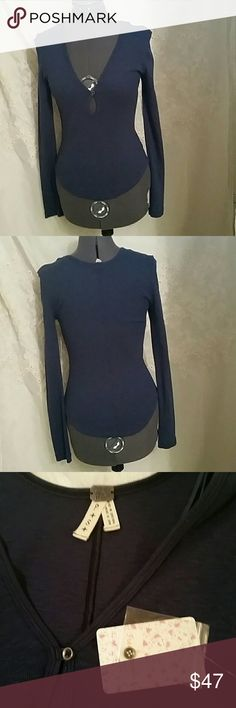 NWT SUPER CUTE FREE PEOPLE TOP This adorable top is in excellent condition. Never been wore. Great for layering.  Indigo color. Free People Tops