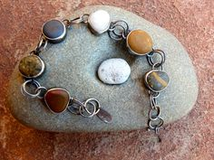 This bracelet is made to order. Yours will not be exactly the same as the one pictured. I can work with you to pick the rocks you would like includ...