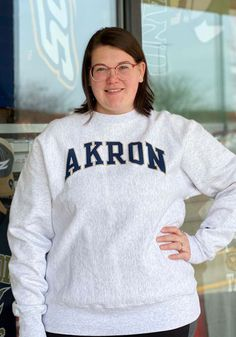 Make a sporty statement with this Akron Zips Champion Mens Grey Reverse Weave Crew Sweatshirt! Rally House has a great selection of new and exclusive Akron Zips t-shirts, hats, gifts and apparel, in-store and online. Akron Zips, Champion Logo, Crew Sweatshirts, Graphic Sweatshirt, T Shirt, Rib Knit, Weave, Sporty, Unisex