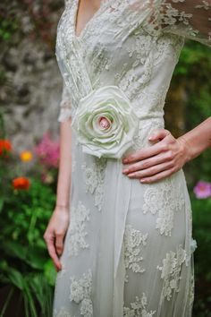 Pale mint green lace wedding dress by Joanne Fleming Design, with handmade silk flower corsage by Rose Garden Accessories.