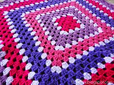 It is crocheted in rounds with pretty shades of strawberry, raspberry, and blueberry in an easy to follow granny square pattern.
