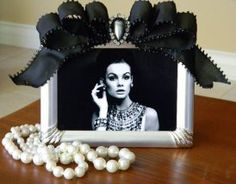 Ornate Silver 7 x 5 picture frame with a Black Bow and a Glamorous Rhinestone Brooch.item may be purchased on ecovolvenow.com. Cheer Banquet, Tiffany Baby Showers, Baby Co, Let's Create, Bereavement, Classic Elegance, Signage, Birthday Ideas, Picture Frames