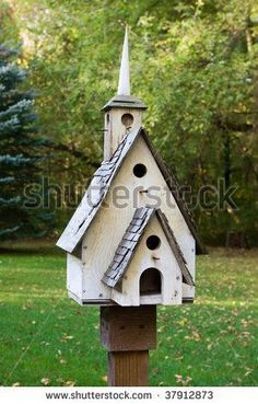 homemade bird houses | Home made wooden bird house on a pole. - stock photo #homemadebirdhouses #woodenbirdhouses #birdhousekits