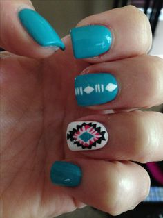 love the accent nail on this Aztec-inspired design