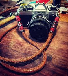 Made my FE a new strap today.  #nikon #film #shootfilm #analogphotography #35mm #goodweatherforducks #analog #filmisnotdead #filmphotographic #filmphotography #filmcommunity #shootfilm #shootfilmstaybroke #shootfilmnotbullets #ishootfilm #handmade #diy #leather #stitching #camera