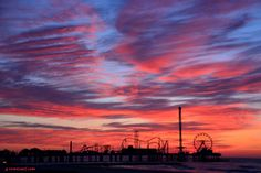 A beautiful morning on the Island. A colorful sunrise over the Galveston Island Historic Pleasure Pier in Texas.