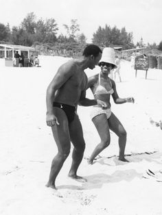 Singer pianist Nina Simone and folk singer Brock Peters relax between shows by frolicking in the sand at Takwa Bay Beach during a visit to Lagos, Nigeria. By G. Marshall Wilson