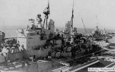 British Battleship HMS Vanguard in port, midship. Hms Vanguard, Heavy Cruiser, Capital Ship, Rubber Raincoats, Naval History, Seafarer, Military Uniforms, Navy Ships, Royal Navy
