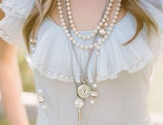the color of the blouse and the soft ruffled neckline