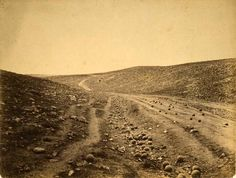 """Shadow of the Valley of Death"" Dirt road in ravine scattered with cannonballs, Crimea, Roger Fenton, 1855 (Library of Congress)"
