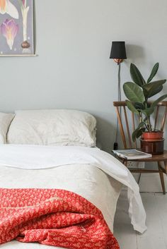 Au Lit Fine Linens | 7 Chic Alternatives to a Bedside Table | Wood chair with plant