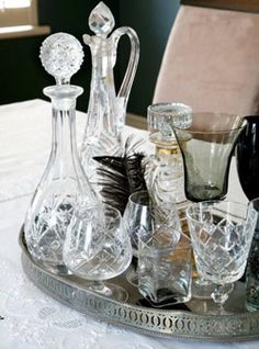 These oval drinks trays are easy enough to find - buy vintage to add charm to the setting with mixed display of decanters and glasses Repinned by www.silver-and-grey.com