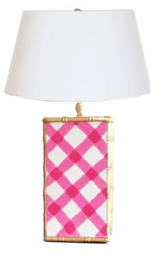 This lovely tole lamp features a gold bamboo frame with a pink and white gingham design. The lamp is hand painted and natural imperfections may occur due to the hand painted nature of this item. The l