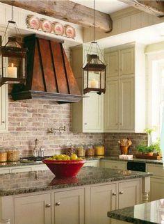Really liking the brick backsplash idea and the contrasting kitchen hood.