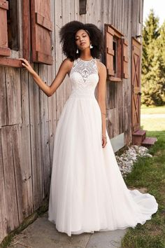 This whimsical English net A-line bridal dress is a boho bride's dream. It features a bold Guipure lace that creates a jewel neckline bodice and modern diamond keyhole back, while the fitted natural waist ensures your figure is contoured. The dreamy skirt features vertical lace trims on the lining creating a soft finish that will peek through in photos. Horsehair at the hem offers a subtle structure to the chapel length train. Lillian West, Wedding Dress Accessories, Bohemian Wedding Dresses, Dream Wedding Dresses, Bridal Dresses, Lace Dress Styles, Wedding Dress Styles, Allure Bridal, Bride