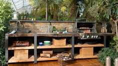 The outdoor kitchen Wood-Line XL with stone back wall