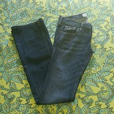 Hollister jeans Dark wash jeans with lots of life left in em. Worn few times still in great condition. They no longer fit so its time for a new home. Size 0 short Hollister Jeans Boot Cut