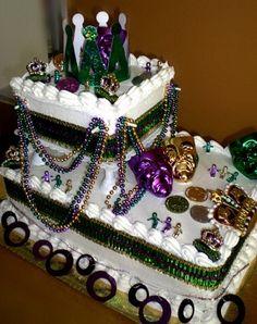 Create a Float Cake that looks like it belongs in a Mardi Gras parade.