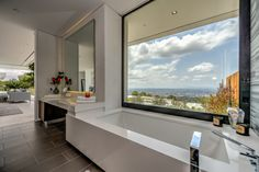 Modern tub with a view   Master Bathroom at Carla Ridge in Beverly Hills By Boswell Construction #buildboswell