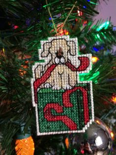 """New Handmade Cross Stitch Christmas Ornament-Puppy in a Present-Dog as a Gift FOR SALE • $8.00 • See Photos! Money Back Guarantee. -Brand new handmade cross stitch Christmas ornament.-Puppy as a present.-14 count beige Aida-Cotton thread brown, red, green, black and white.-Backed in green felt.-Total piece measures 1 1/8""""w and 2 5/8""""h.-Carefully 122316307298"""