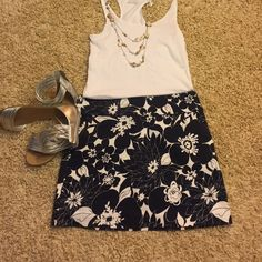 "J. Crew skirt Adorable blue and white floral print skirt with side zip and two front pockets. 15 1/2"" long. Great condition!  J. Crew Skirts"