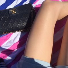 girl laying on towel with chanel bag http://styledamerican.com/newport-harbor-ferry/