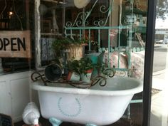 Amazing Cast Iron Tub with turquoise stenciling, another cast iron antique urn and Iron bench~also a pair of turquoise gates and a wooden glider!  ALL available at American Home & Garden in Ventura CA