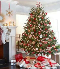 Beautiful tree and stockings hung by the fire