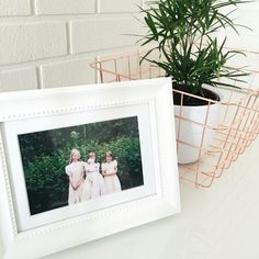 """Cute and old pic of me and my sisters next to my lovely plant. Loving the copper/rose gold """"box"""" that it lives in!"""