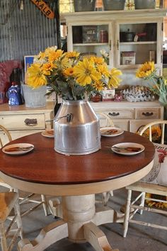 A round kitchen table...it's a good thing  I like the real wood top with the distressed white/beige pedestal.