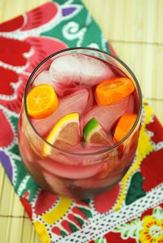 Sangria    1.5 liters red wine (I use Carlo Rossi Sangria)  3/4 cup orange juice  1/2 cup white wine (Sauvignon Blanc or another mild white)  1/2 cup brandy  1/2 cup triple sec  slices of limes, lemons, oranges (optional)    Mix all ingredients together in a large pitcher. Refrigerate until chilled. Serve over ice.